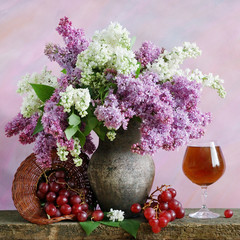 Still life with lilac, grapes and red wine