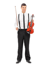 Young male violinist posing