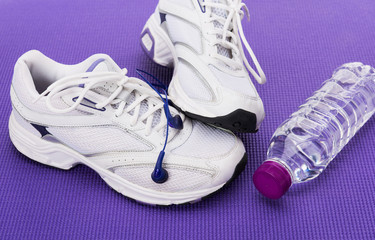 Fitness background, sneakers and headphones