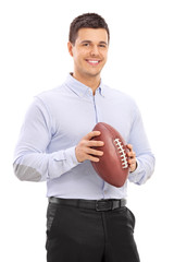 Man holding an American football and posing