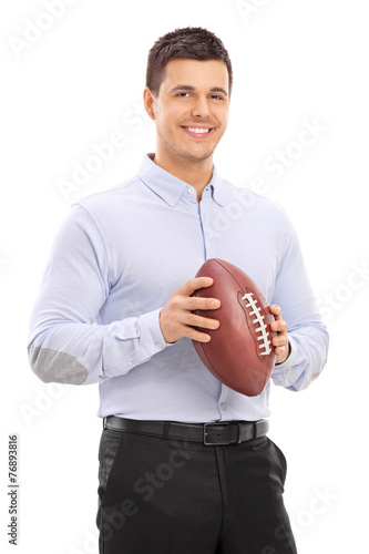canvas print picture Man holding an American football and posing