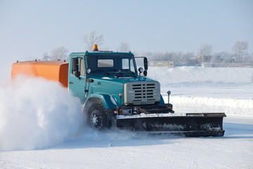 Snowplow is cleaning a road