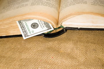 Open book with a bookmark is on sacking