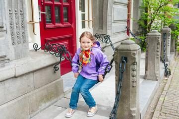 Adorable kid girl playing on a street