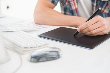 Designer using digitizer at desk