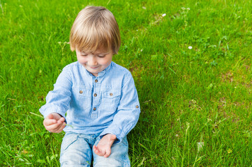 Little boy playing outdoors