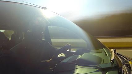Driving a car, camera aimed at the driver.