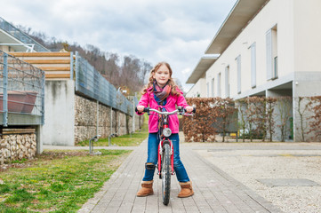 Portrait of a little girl with a bicycle