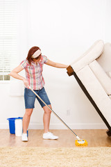 Cleaning: Lifting a Couch to Clean Under