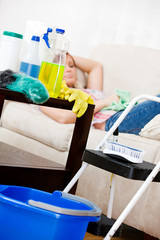 Cleaning: Cleaning Supplies with Woman Sleeping
