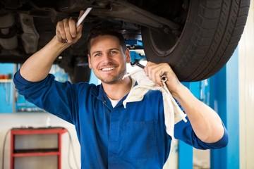 Mechanic examining under the car
