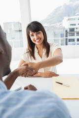 Handshake to seal a deal after a business meeting