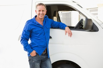 Smiling man leaning against his delivery van