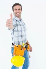 Confident technician gesturing thumbs up