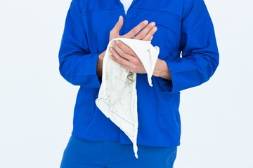Cropped image of mechanic wiping hand with napkin