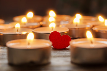 Red heart with candles on lights background, love concept