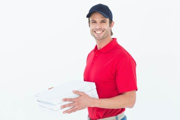 Happy delivery man holding pizza boxes
