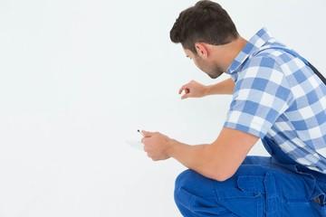 Handyman analyzing while holding clipboard