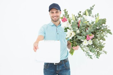 Flower delivery man showing clipboard