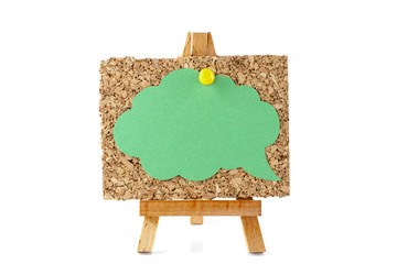Wooden easel with corkboard and green speech bubble