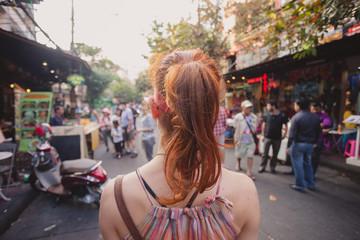 Woman walking in the street in Asia