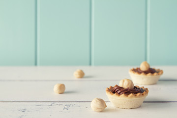 Tartlets with chocolate and hazelnut cream. Vintage look.
