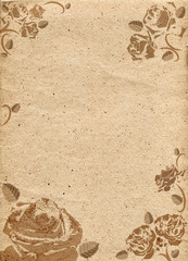 Paper in beige color tone with ornament in form of roses