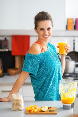 Portrait of smiling fitness young woman with glass of smoothie