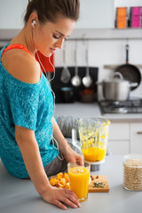 Fitness young woman with glass of pumpkin smoothie