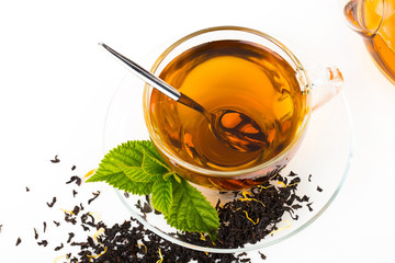 Glass Cup Tea with camomile flower and Mint Leaf, on white backg