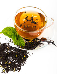 Glass Cup Tea with camomile flower and Mint Leaf, on white