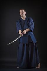 kendo fighter posing with bokken