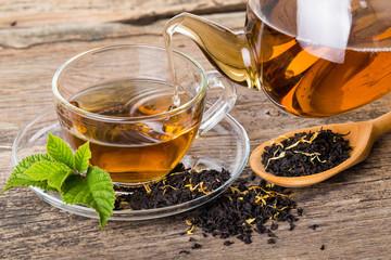 Tea composition with mint leaf on wooden palette