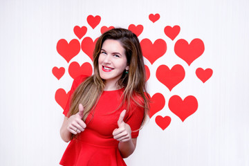 Woman giving thumbs up and smiling on heart background.Valentine