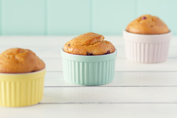 Three classic whiteware baking bowls with three muffins