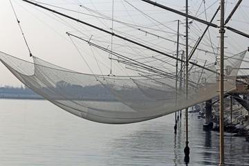 fishing nets over the Stilt houses of wood