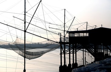 huge fishing nets over the  pile dwellings of wood