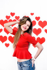 Woman standing playing with hair on heart background.Valentine`s