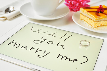 will you marry me? written in a tablet computer