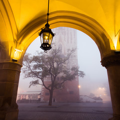 Arch on the market square in Krakow at morning fog