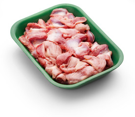 Raw chicken stomach in a green tray over white background