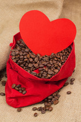 Coffe beans in red velvet sac with red heart