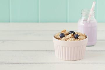 Cereals, blueberries, a school milk bottle (blueberry smoothie)