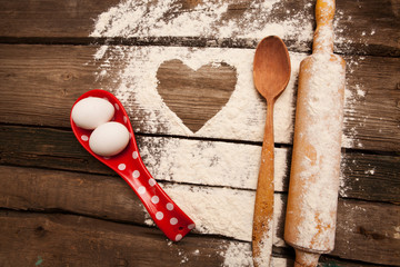 Baking, eggs, flour, plunger in rural kitchen  on wood table