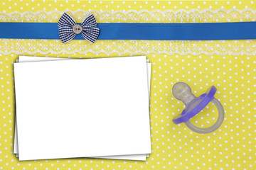 Stack of paper sheets and blue pacifier on polka dots background