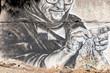 Knitting grandma as graffiti on wall on the road to Rethymno