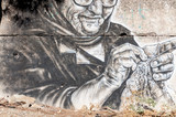 Knitting grandma as graffiti on wall on the road to Rethymno - 76908496
