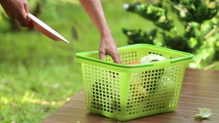 man pour vegetables to basket for cooking soup borsch