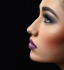 portrait of beautiful girl with makeup on black background