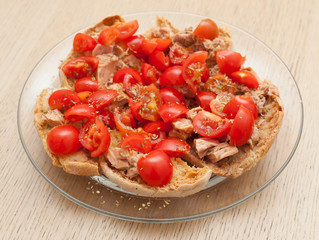 Dried bread called freselle with tuna and tomatoes